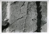 Close-up of hieroglyphs on cracked surface