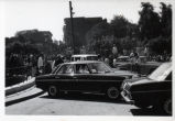Crowd watches Henry Kissinger's car arrive at the Coptic Museum