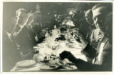 Closeup of Los Angeles Chamber of Commerce representatives at dining table, raising glasses