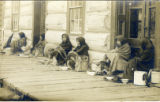 Postcard, Women sitting on wooden sidewalk